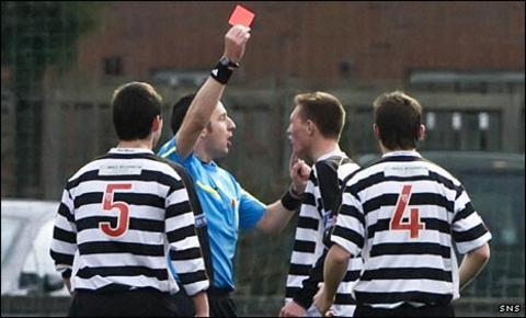 Ryan Frances is shown the red card