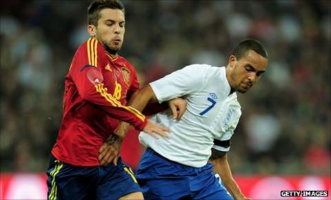 England winger Theo Walcott takes on Jordi Alba of Spain in the friendly at Wembley