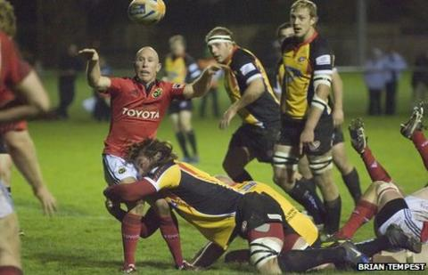 Ian Nimmo gets to grips with former Ireland scrum-half Peter Stringer