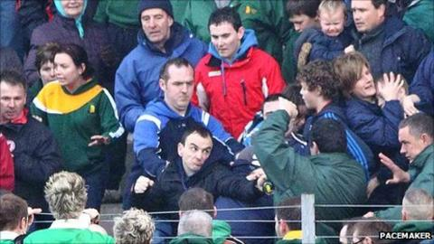 Trouble flares in the stands during the Tyrone football league final