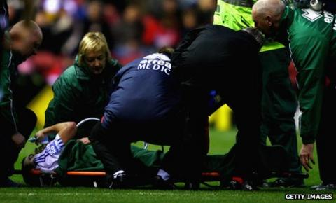 Mike Pearson receives treatment for a broken ankle and leg at Middlesbrough in 2009