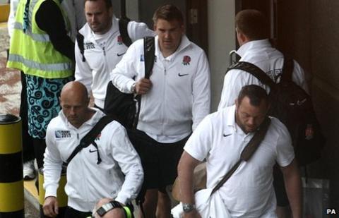 England players at Heathrow