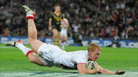 Jack Reed of England scores a try