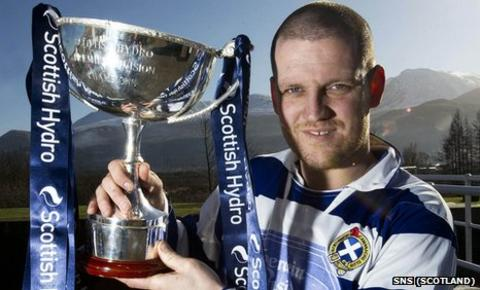 Newtonmore's Norman Campbell poses with the Camanachd Cup