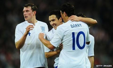 England celebrate scoring against Sweden