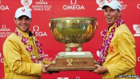 Gary Woodland and Matt Kuchar with the World Cup trophy