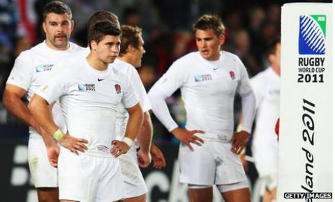 Ben Youngs (centre) and England team-mates after their Rugby World Cup defeat by France