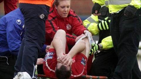Tim Mouncey is treated after suffering the knee injury at New Grosvenor