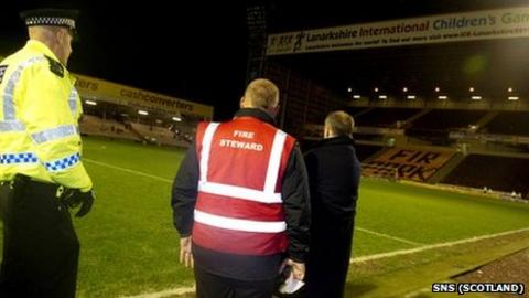 Police and stewards at Fir Park