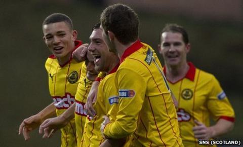 Partick Thistle players celebrate Conrad Balatoni's goal against Livingston
