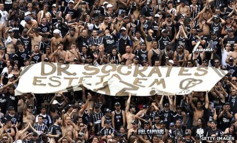 Corinthians fans hold up Socrates banner