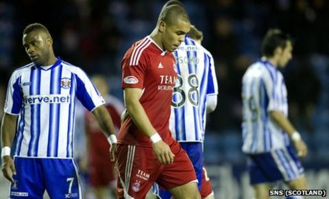 Aberdeen's Josh Magennis cuts a dejected figure at Rugby Park
