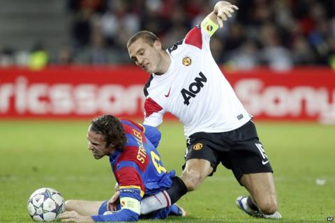 Nemanja Vidic is injured in a tackle with goalscorer Marco Streller