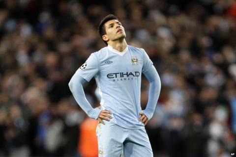 Sergio Aguero looks to the sky as his side go out of the Champions League