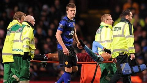 Jenas is stretchered off after injuring his Achilles against Manchester United