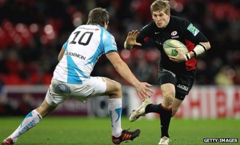 Saracens wing David Strettle tries to evade Ospreys fly-half Dan Biggar