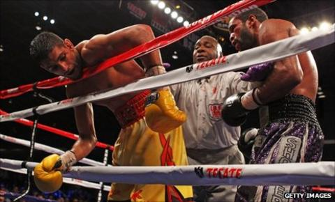 Amir Khan on the ropes against Lamont Peterson in Washington DC
