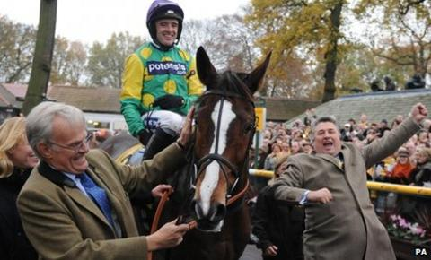 Kauto Star enters the winners enclosure with rider Ruby Walsh, owner Clive Smith (left) and trainer Paul Nicholls (right) after winning the Betfair Chase