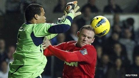 Michel Vorm beats Wayne Rooney in an aerial challenge