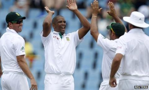 Vernon Philander (second left) is congratulated by his South Africa team-mates