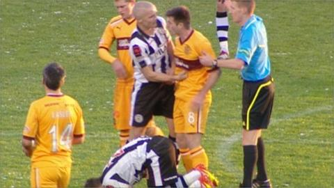 St Mirren's Jim Goodwin(centre) lands punch
