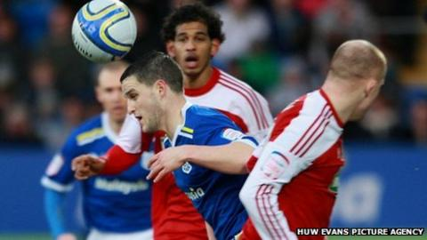 Cardiff's Craig Conway bursts through the Middlesbrough midfield