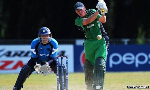 Ireland's Kevin O'Brien hits out, watched by Scotland wicketkeeper Douglas Lockhart