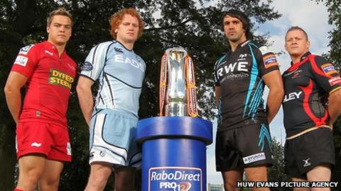 Representatives from the four Welsh regions with the Pro12 trophy
