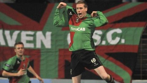 Darren Boyce leaps for joy after scoring the only goal at the Oval