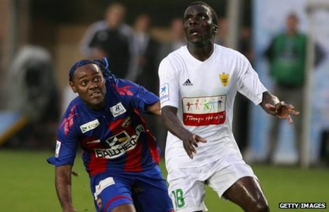 Benoit Angbwa (right) in action for Anzhi Makachkala