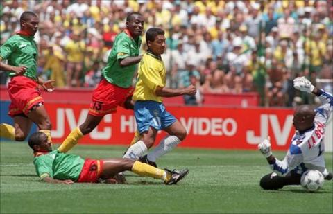 Romario (in yellow) scores against Cameroon in Brazil's 3-0 group win at the 1994 World Cup in the United States