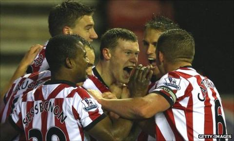 James McClean celebrates with team-mates after his Sunderland goal