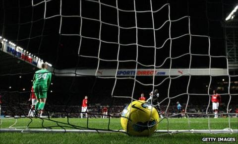 Ball nestles in the Manchester United net after Demba Ba's goal