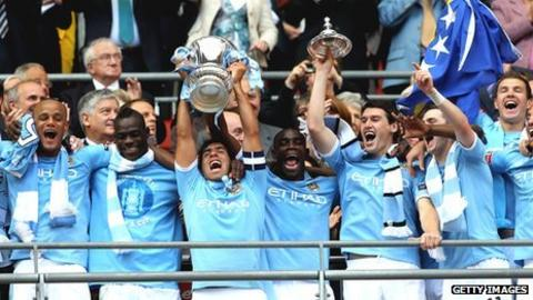 Carlos Tevez lifts the FA Cup following Man City's win over Stoke in last season's final