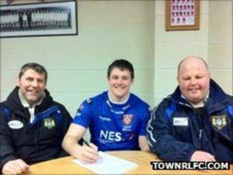 Daniel Rooney signs his contract with Martin Oglanby and Malcolm Allison