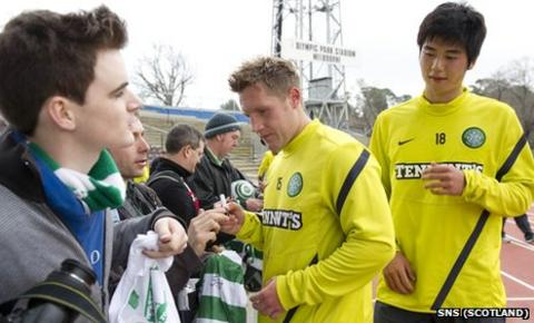 Kris Commons and Ki Sung-Yueng sign autographs for Celtic fans in Melbourne