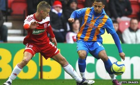 Lionel Ainsworth of Shrewsbury and Joe Bennett of Middlesbrough