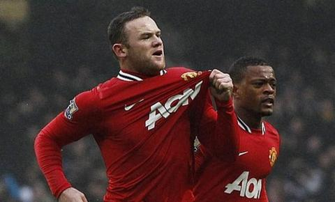 Wayne Rooney celebrates his first goal at the Etihad