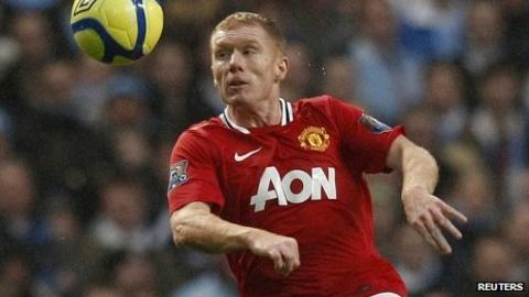 Paul Scholes in action against Manchester City
