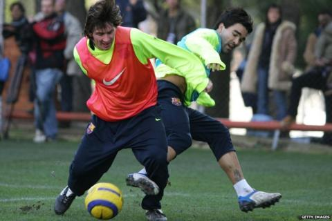 Messi trains at La Masia with team-mate Deco