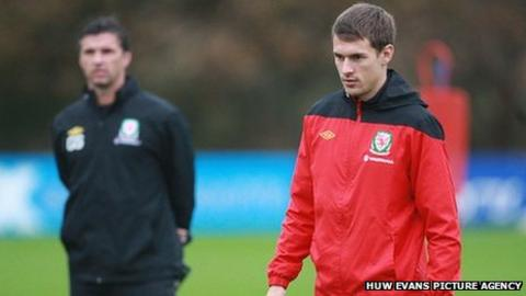 Former Wales coach Gary Speed (background) and captain Aaron Ramsey