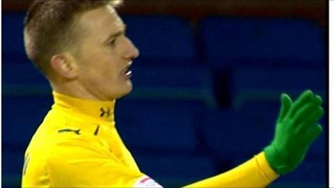 Derek Riordan scores against Kilmarnock.