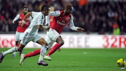 Arsenal's defender Johan Djourou and Swansea City's Scott Sinclair