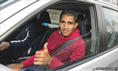 Jorge Claros is whisked away from Glasgow Airport