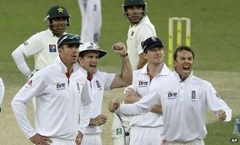 England celebrate the late wicket for Graeme Swann