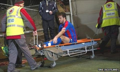 Roman Golobart on a stretcher