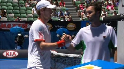 Andy Murray shakes hands with Mikhail Kukushkin