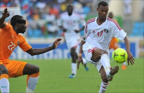 Sol Bamba (left) vies for possession with Sudan's Mudathir