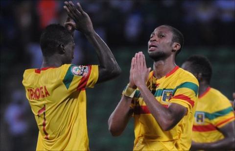 Abdou Traore and Seydou Keita (right)