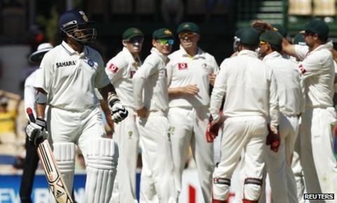 Australia celebrate the dismissal of Sachin Tendulkar (left)